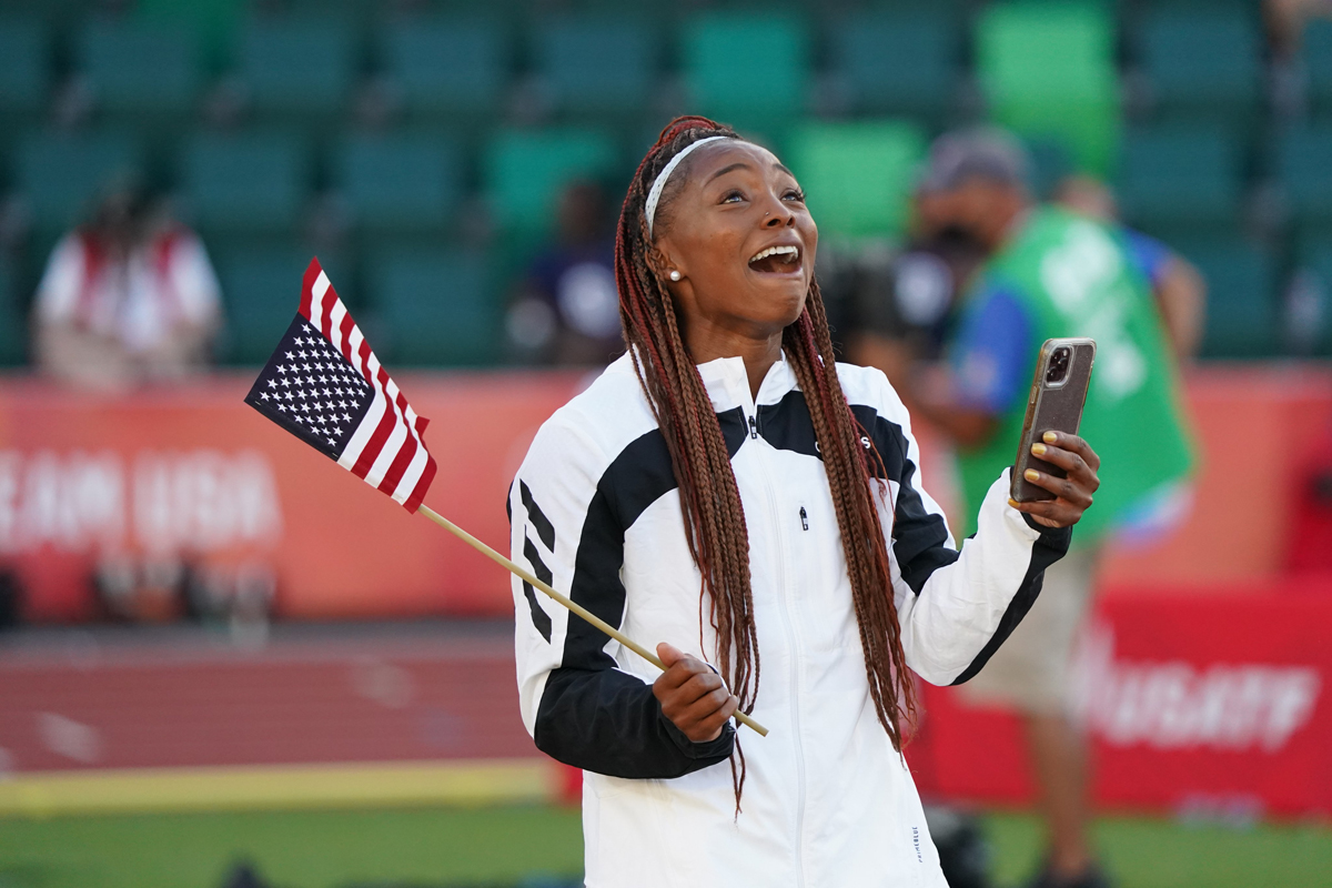 Quanesha Burks makes a phone call after qualifying for Olympic team